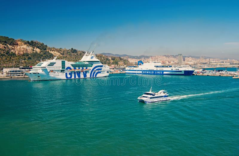 Barcelona, Spain - March 30, 2016: ocean liners GNV and Grimaldi Lines in sea port. Cruise liner destination and trip. Summer vacation and holiday. Wanderlust royalty free stock photo