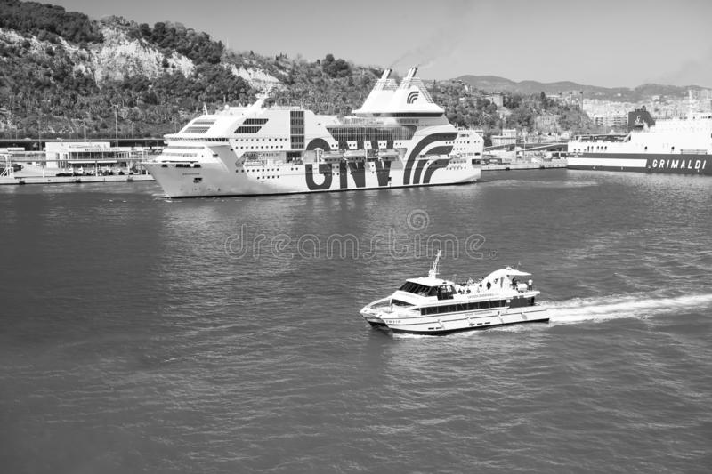 Barcelona, Spain - March 30, 2016: pleasure boat and cruise ships GNV, Grimaldi Lines in sea. Water transportation of. Pleasure boat. Travelling by sea on royalty free stock photos