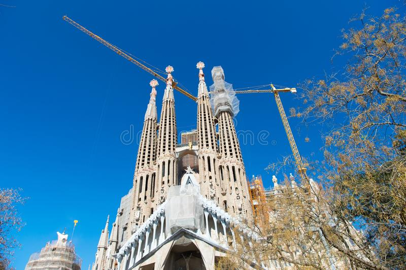 Barcelona, Spain - March 30, 2016: Sagrada familia and cranes on blue sky. Basilica and expiatory church of Holy Family stock images