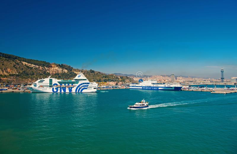 Barcelona, Spain - March 30, 2016: ships GNV and Grimaldi Lines in sea port. Travelling by sea. Summer vacation on ship stock photography