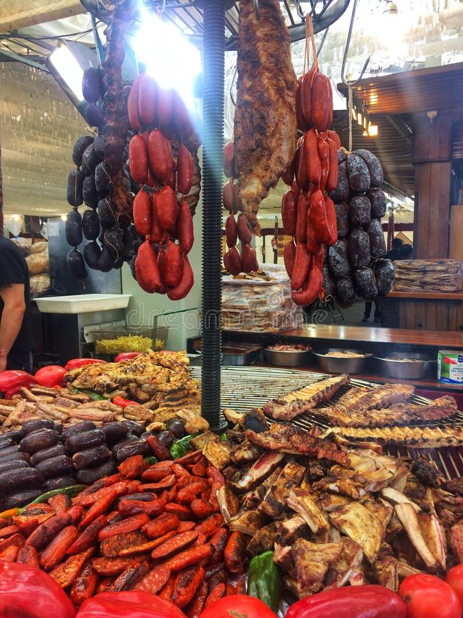 Barcelona, Spain, May 2018:Тrade tray with various bbq grill food meat sausages, pork vegetables food on gastronomic festival. Barcelona, Spain, May 2018 royalty free stock photo