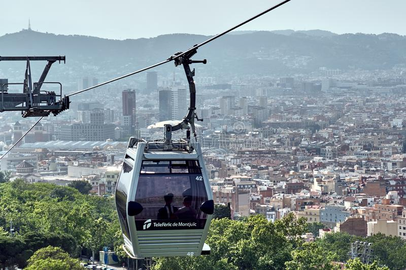 Barcelona, Spain - May, 27 2018: Cable car cabin with historic Barcelona on background royalty free stock photography