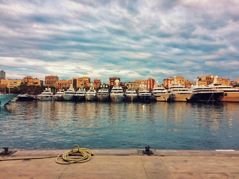 Barcelona, Spain, May 2018: Charter Superyachts in harbour of Barcelona. Barcelona, Spain, May 2018: Superyachts on fair in harbour of Barcelona on sunset stock photo
