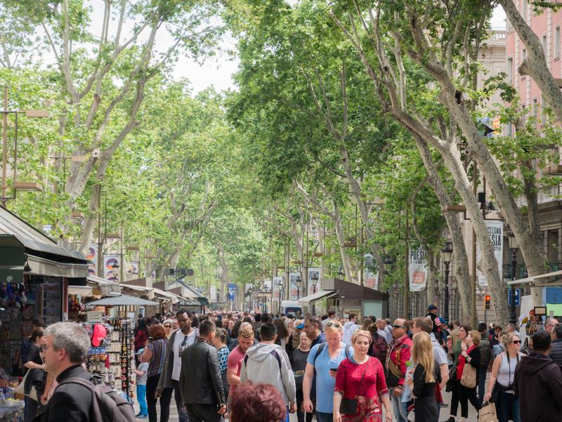 Barcelona, Spain - May 2019. - Crowds of people shopping along Las Ramblas on a pleasant summer day stock image
