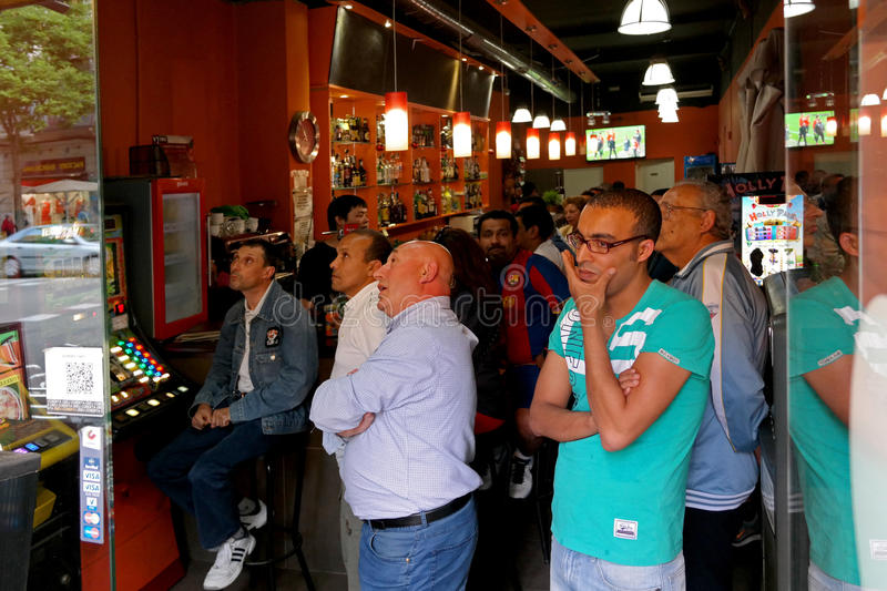 Barcelona, Spain - May 17, 2014: FC Barcelona fans watching a football match in a sports bar royalty free stock photo