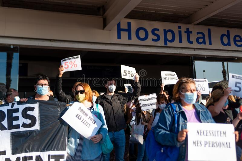 Barcelona, Spain - 20 may 2020: nurses protest during corona virus crisis, for the lack of personnel and pay cuts, wearing face stock image