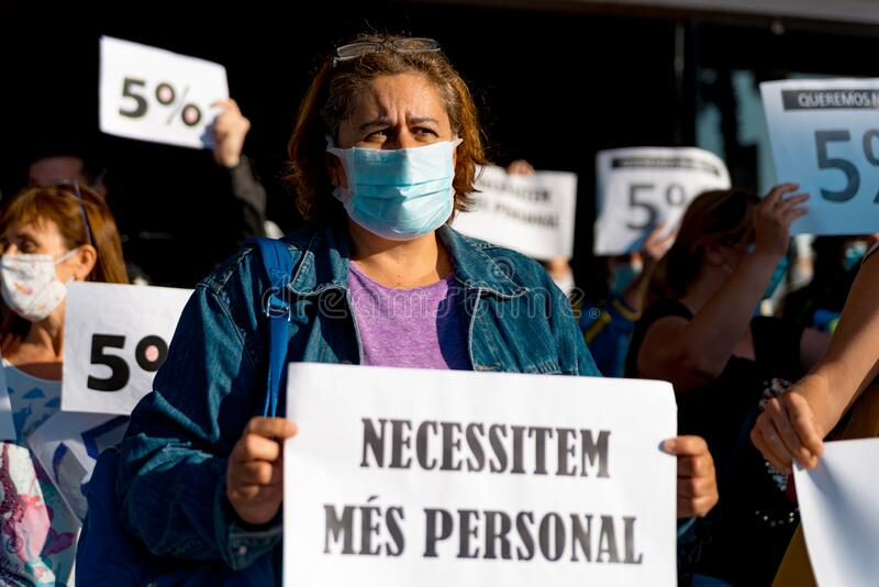 Barcelona, Spain - 20 may 2020: nurses protest during corona virus crisis, for the lack of personnel and pay cuts, wearing face stock photos