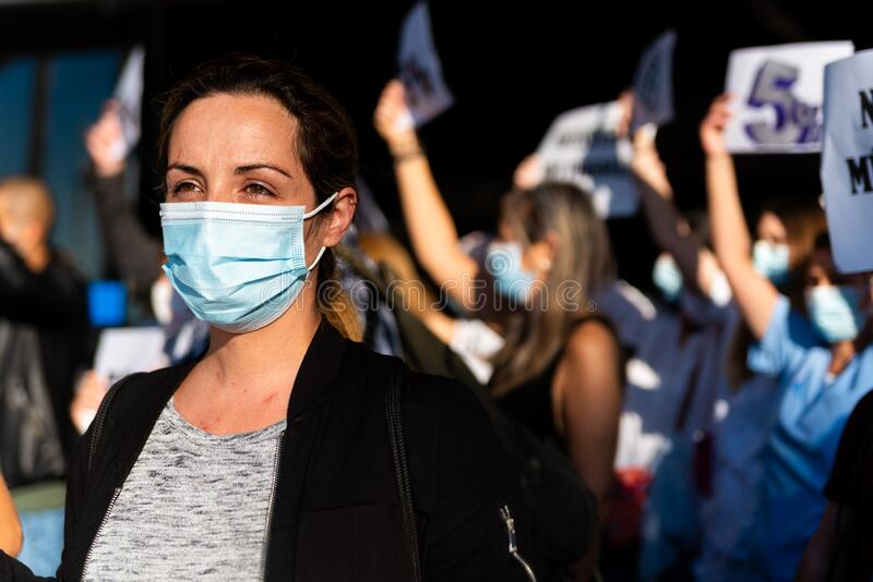 Barcelona, Spain - 20 may 2020: nurses protest during corona virus crisis, for the lack of personnel and pay cuts, wearing face royalty free stock images