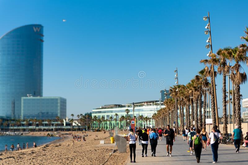 Barcelona, Spain - 2 may 2020: people do sport in barceloneta beach wearing protection face mask against coronavirus, after the royalty free stock images