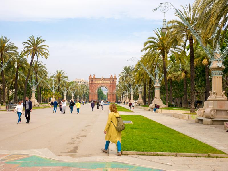 Barcelona, Spain. May 2019. People are strolling through an alley between the arch of triumph and ciutadella park Barcelona, Spain royalty free stock photos