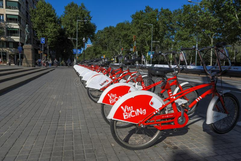 BARCELONA, SPAIN - May 2, 2018: Red bicycles for rent at the bike station in the street royalty free stock photo