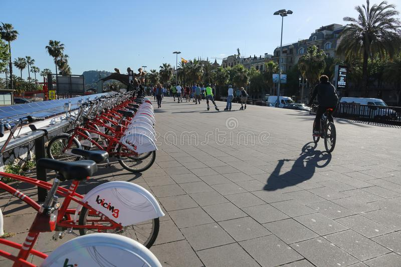 BARCELONA, SPAIN - May 2, 2018: Red bicycles for rent at the bike station in the street stock photos