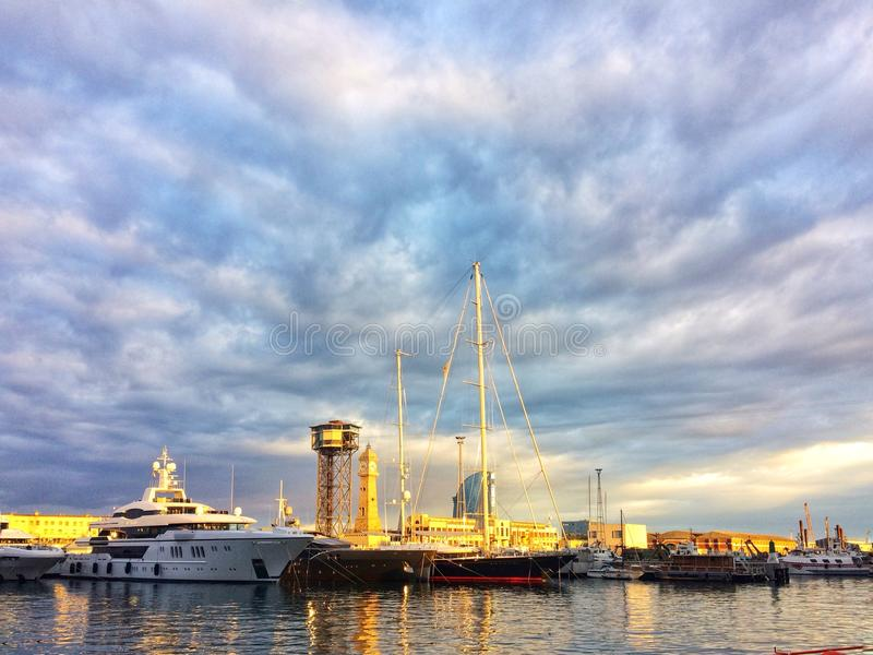 Barcelona, Spain, May 2018: Stock of Super yachts in harbour of Barcelona. On sunset. Fair of charter services stock images