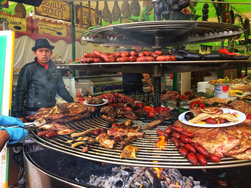 Barcelona, Spain, May 2018: Tray with food meat sausages, pork and vegetables food on gastronomic festival. royalty free stock photography