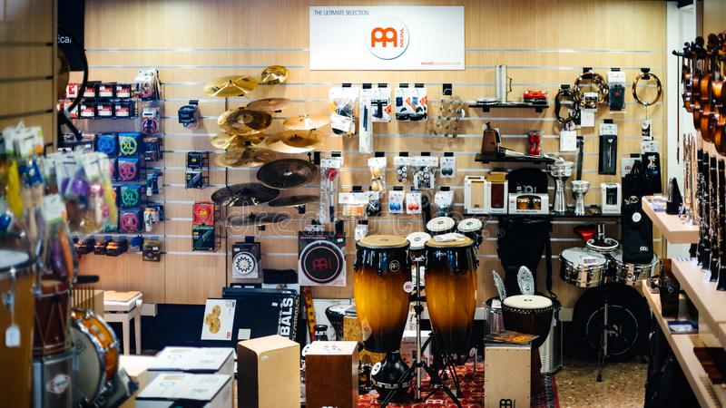 INterior of musical store with lots of instrument. Barcelona, Spain - Nov 14, 2017: Musical instrument store selling diverse objects guitars, drums, accessories royalty free stock photo