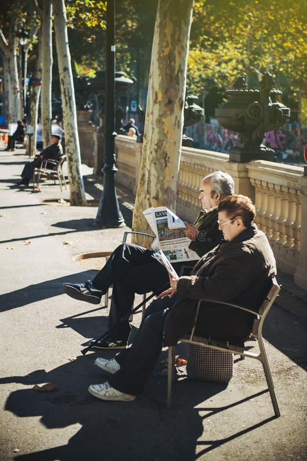 panish senior couple reading La Vanguardia stock images