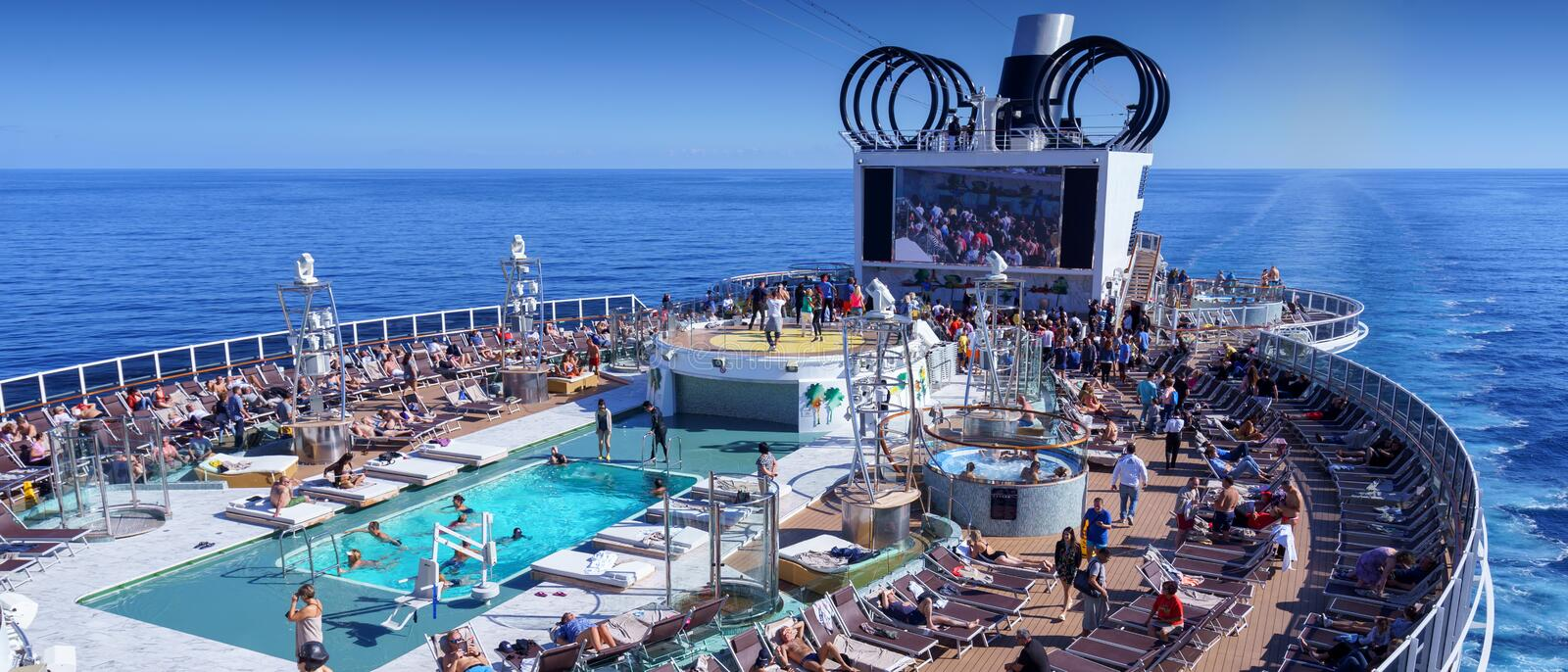 BARCELONA, SPAIN- 06 NOVEMBER, 2018: An aerial view of a cruise ship pool area with people in the open sea royalty free stock photo
