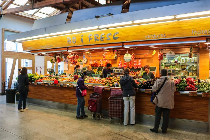 Local market in Barcelona Spain. BARCELONA, SPAIN - NOVEMBER 20, 2015 : Local people are purchasing at fruits and vegetables vendor in Santa Caterina Market royalty free stock photos