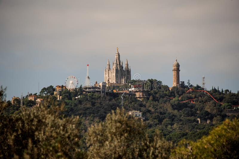 BARCELONA, SPAIN - NOVEMBER 4, 2018: View of Tibidabo mountain with a theme park and Expiatory Church of the Sacred stock images