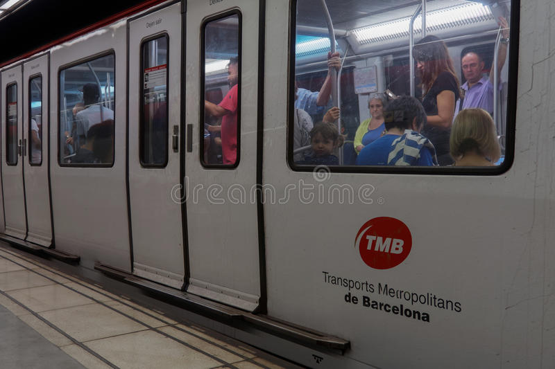 Barcelona, Spain - 24 September 2016: Barcelona metro coach stopped at platform. Metro wagon of TMB Transports Metropolitans de Barcelona with passengers inside stock photos