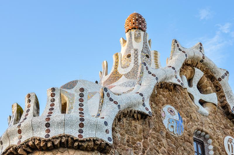 Barcelona, Spain - September 16, 2015: Park Guell by architect Antoni Gaudi in Barcelona, Spain. Pavilion top  at the entrance of stock photo