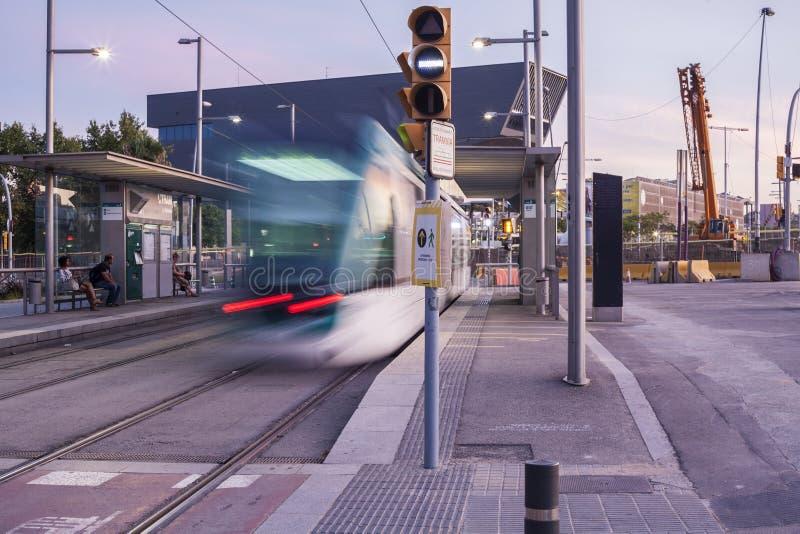 Barcelona tram at dusk. Low motion shot stock image