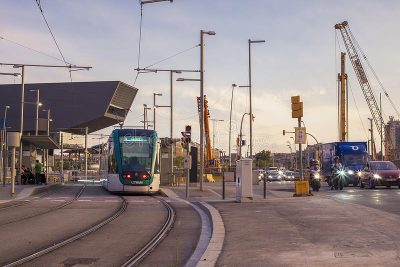 Barcelona tram at dusk. BARCELONA, SPAIN - JULY 27, 2016: Barcelona tram in motion. The tram is going through the Diagonal avenue stock photo