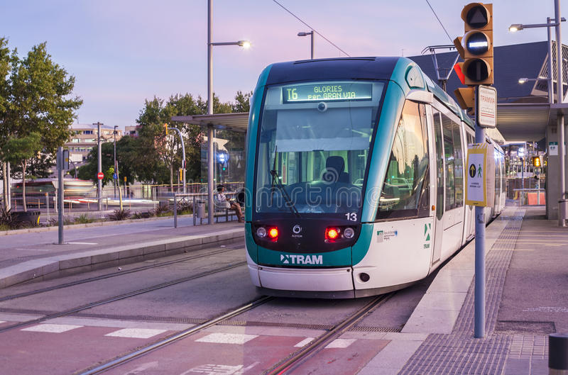Barcelona tram at dusk. BARCELONA, SPAIN - JULY 27, 2016: Barcelona at sunset. The tram is going through the Diagonal avenue royalty free stock images