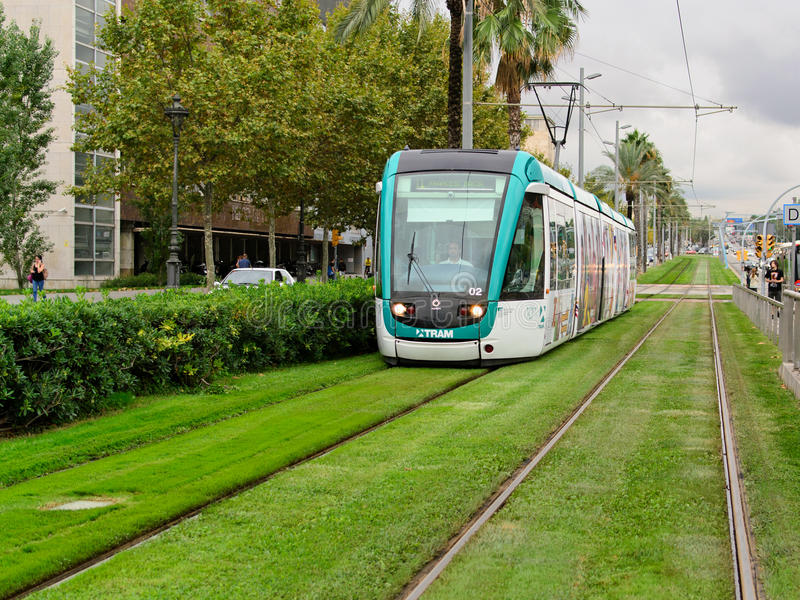 Barcelona tram. The tram lane covered with grass in Barcelona, Spain stock images