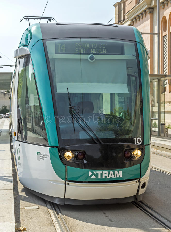 Barcelona tramway. BARCELONA, SPAIN - JULY 12, 2015: Barcelona tram known as Trambaix. The tram is going through the Diagonal avenue royalty free stock image