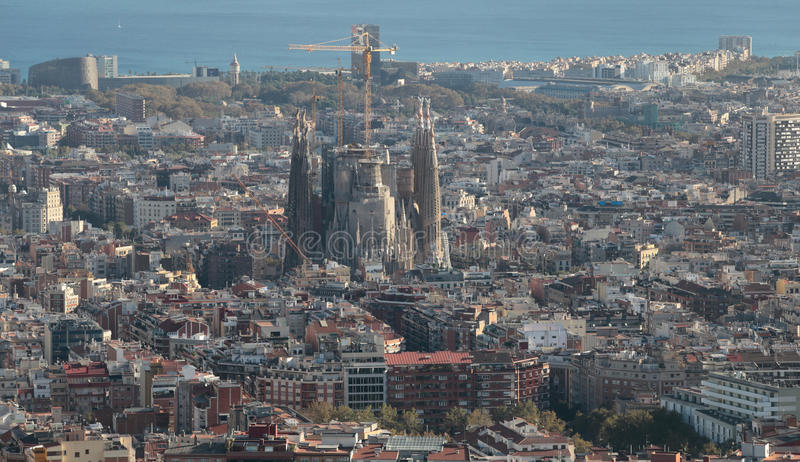 Barcelona view with Sagrada Familia on main term. The city of Barcelona, skyline view from nearby hill of Turo de la Rovira where the constructions crane of the stock image
