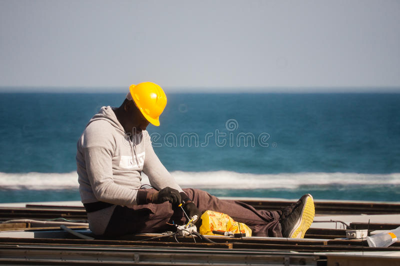 Barceloneta,Barcelona, Spain, March 2016: electrician work on a roof royalty free stock photography