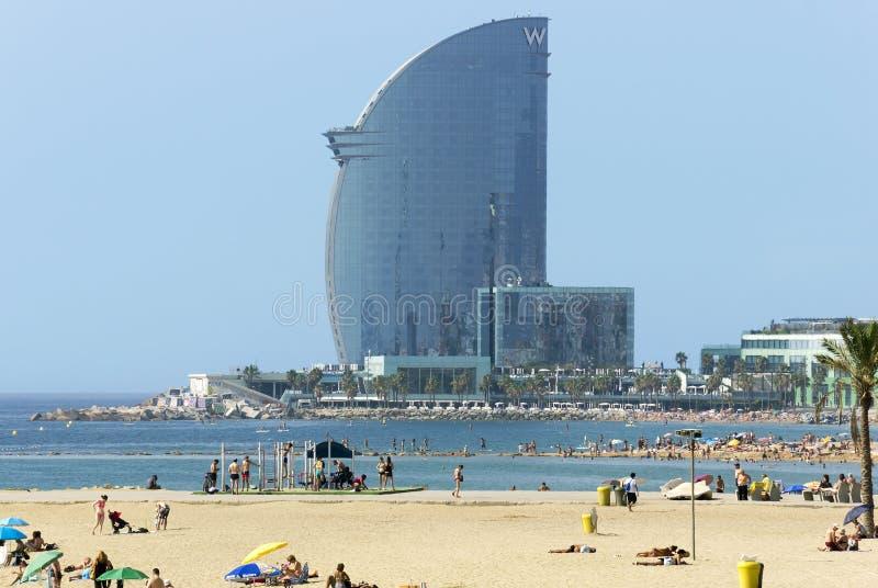Barceloneta Beach and Hotel Vela. BARCELONA, SPAIN - JULY 12, 2015: Barceloneta Beach and Hotel Vela, designed by Architect Ricardo Bofill. Located on the new royalty free stock photo