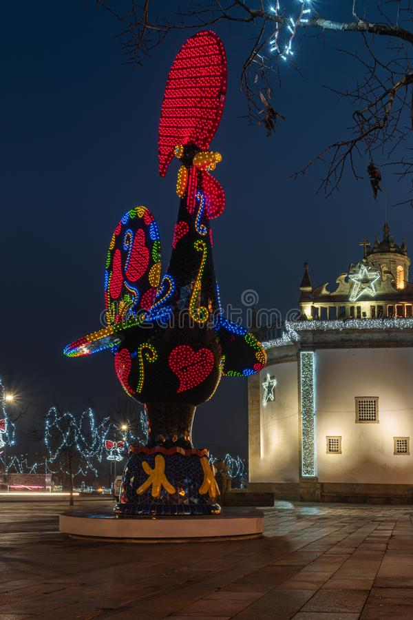 BARCELOS, PORTUGAL - CIRCA JAUARY 2019: View at the Pop Galo at night, public art inspired in the Barcelos cock, cosidered one of. The most important symbols of royalty free stock photo