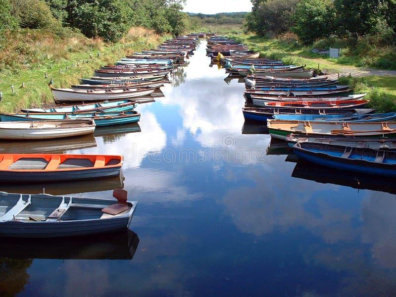 Barche e cielo fotografie stock
