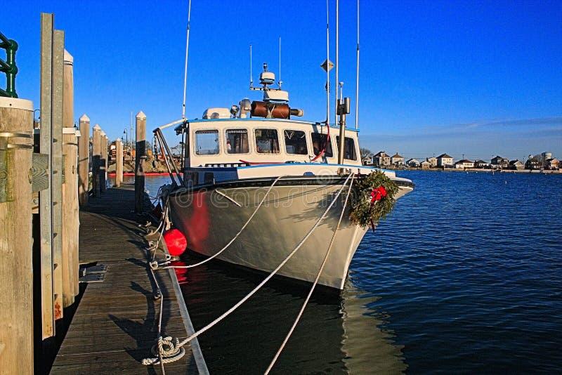 Barco de la langosta en la Navidad imagen de archivo