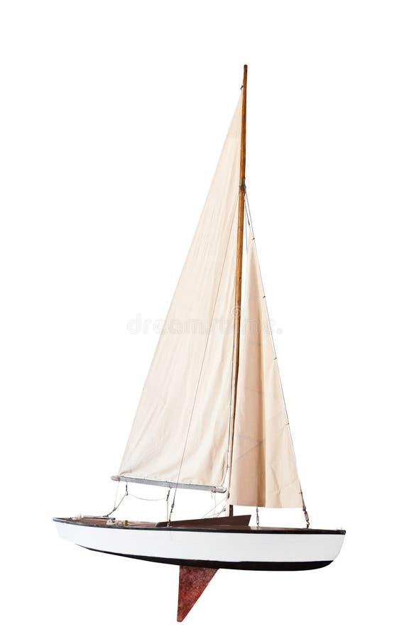 Barco de la velocidad con las velas desplegadas imagen de archivo