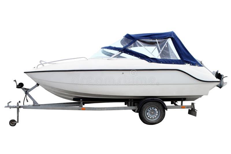 Barco de motor blanco con un toldo azul imágenes de archivo libres de regalías