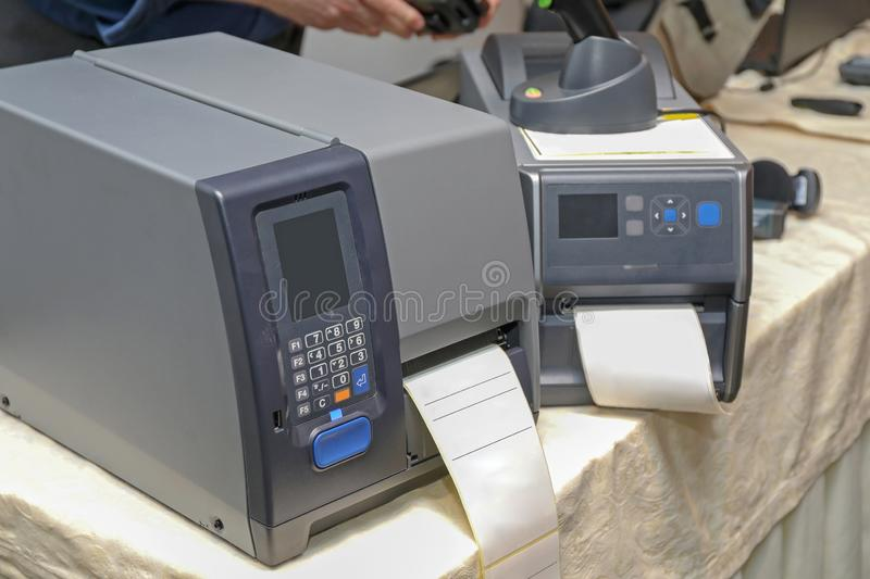 Barcode Label Printers. Two Barcode Label Printers Equipment for Distribution Warehouse royalty free stock photography