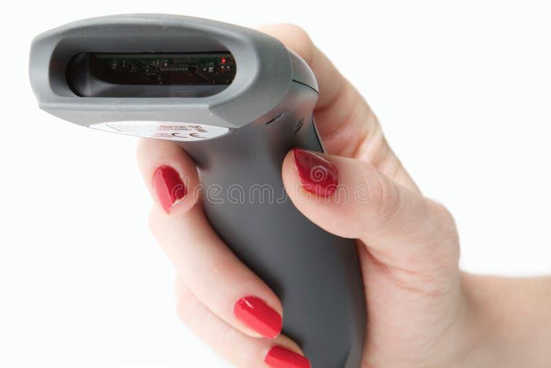 Barcode reader. Woman holding a handheld barcode reader royalty free stock photos