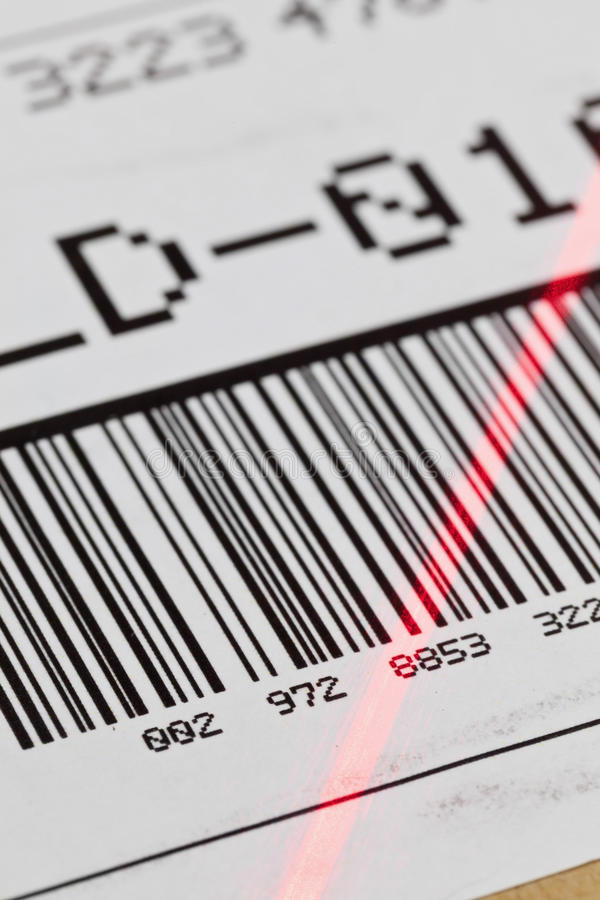 Barcode scan. Barcode on shipping label on box scanned by automatic laser scanner royalty free stock photography