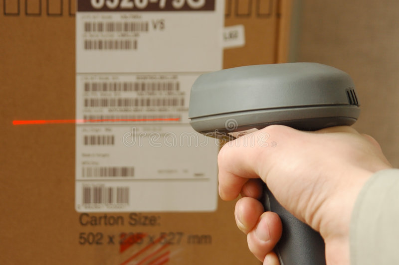 Barcode scaner in hands for a man stock photography
