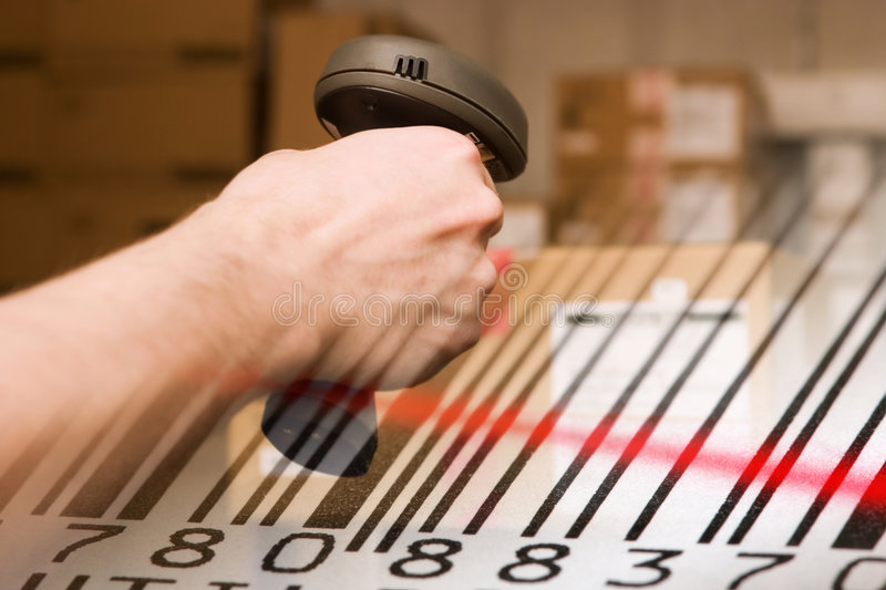 Barcode scanner and label close-up. stock photos