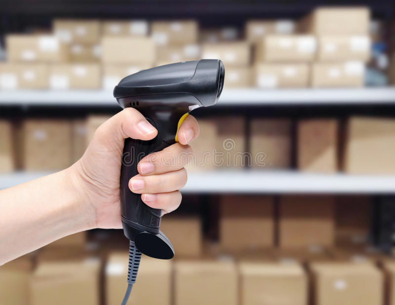 Barcodescanner in der Hand lizenzfreies stockfoto