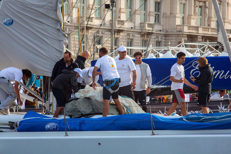 Barcolana, 2013. TRIESTE, ITALY - 11 OCTOBER 2013: The crew of sailboat haul down the sails the day before the 45 Barcolana regatta in Trieste on October 11 stock images