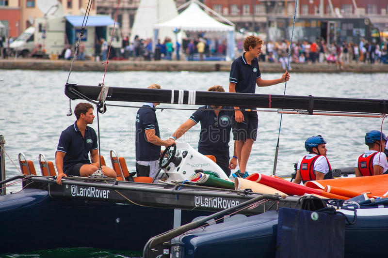 46 Barcolana 2014, Trieste. TRIESTE, ITALY - OCTOBER, 12: The crew of sailboat haul down the sails during the 46° Barcolana regatta in Trieste sea on October stock images