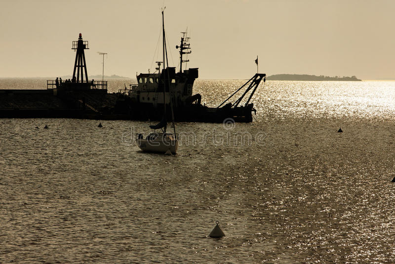 Barcos no por do sol fotografia de stock