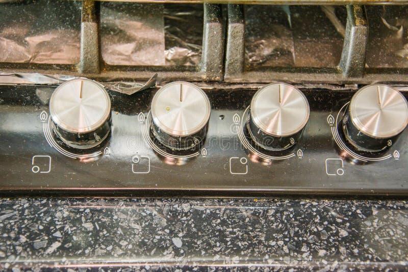 Bardzo brudna kuchenka gazowa Tło The Brudy and Grimy Top of Gas Cooker Hob zdjęcie stock