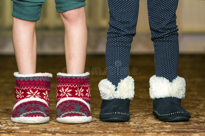 Bare child legs and feet in red winter christmas boots with ornament pattern stock images