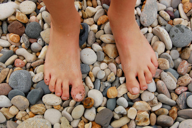 Download Bare feet on beach stock photo. Image of rocks, rock - 20104016